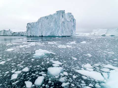 Huge glaciers are on the arctic ocean in Ilulissat, Greenland 585073290