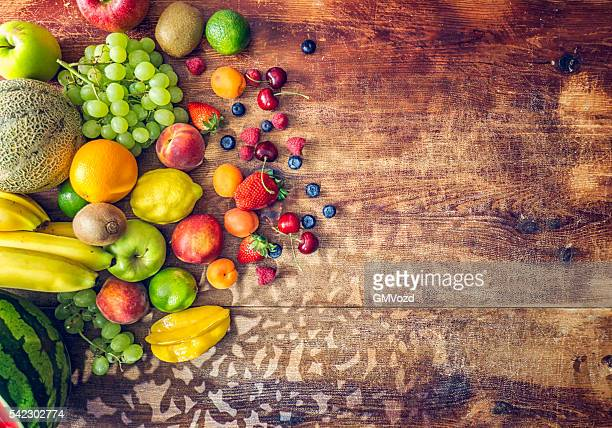 huge group of fresh fruits on wooden background - tropical fruit stock pictures, royalty-free photos & images