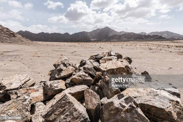 huge heap with boulders in front of the mountain - front view ストックフォトと画像