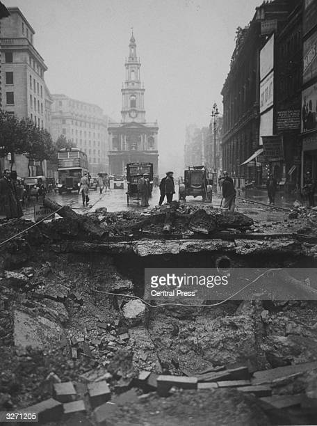 A huge hole in the Strand where a bomb was dropped during an air raid over central London It fell near the Gaiety Theatre and the church of St...