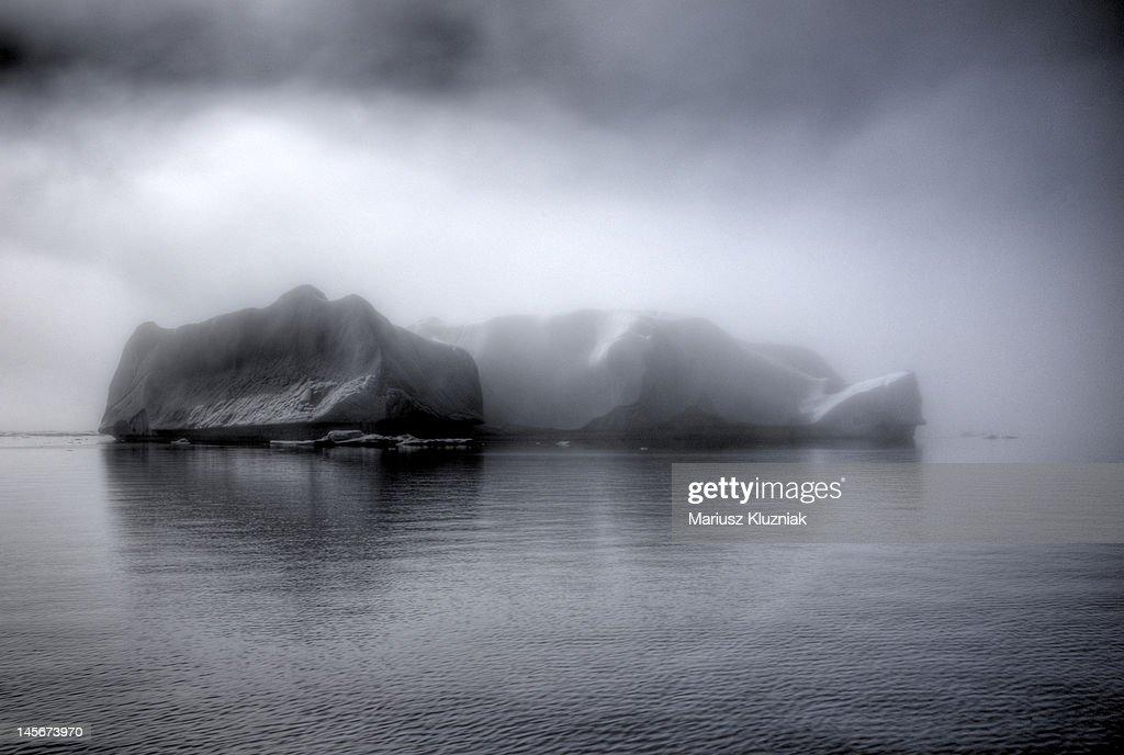 Huge Icebergs in mist : Stock Photo