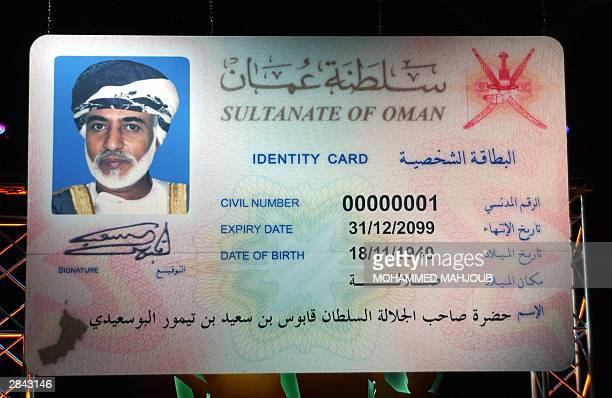 A huge ID card 00000001 bearing the name of Sultan Qaboos bin Said his signature and his picture is seen during the inauguration of the new ID card...