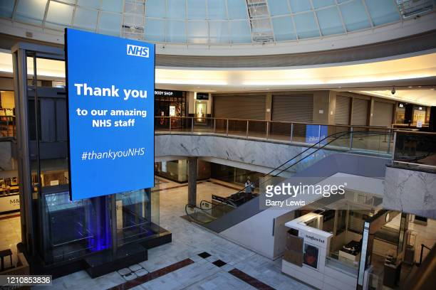 A huge LED screen thanking health workers in Brent Cross Shopping Centre which is nearly deserted with only one food store staying open during the...