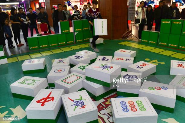A huge Mahjong game is holding in a shopping mall attracts many people to come on 26th November 2017 in HohhotInner Mongolia China