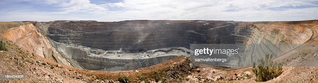 A huge mining superpit on a sunny day : Stock Photo