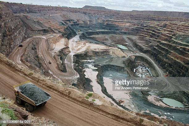 A huge mining truck hauls a big load of ore from the pit at Orapa mine the largest diamond mine in the world on March 17 2008 in Orapa Botswana It's...