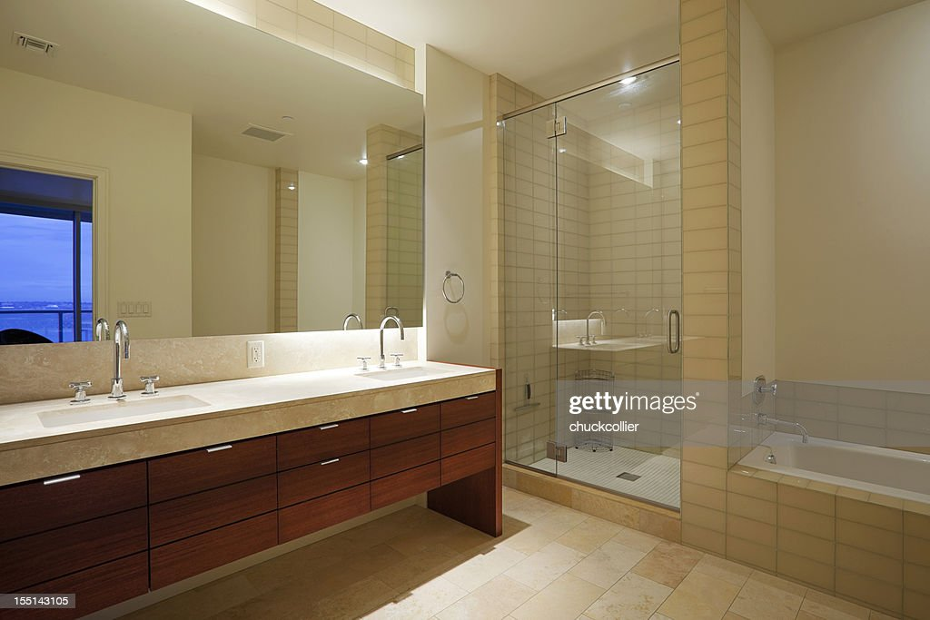 A Huge Modern Bathroom With Two Sinks Shower And Tub Stock Photo
