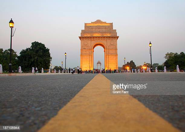 huge monument at evening light. - india gate stock pictures, royalty-free photos & images