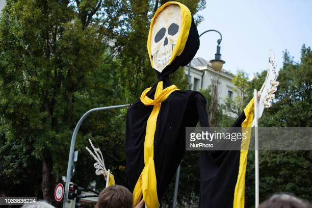 Huge Muenchner Kindl puppet with a skull. Among the police more than 7000 people protested under the motto #Ausspekuliert against too high rentals in...