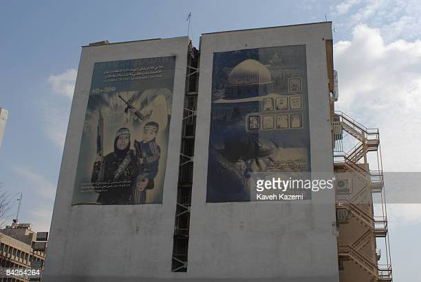 A huge mural in Tehran shows a Palestinian woman suicide bomber holding her child in one arm and a machine gun in the other 22nd March 2007 She...