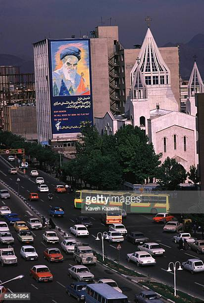 Huge mural of Ayatollah Khomeini on a building next to an Armenian church, Tehran, Iran, 28th February 1996.