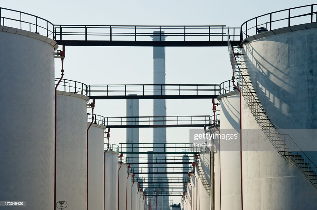 Huge oil tanks with ladders on the side : Stock Photo