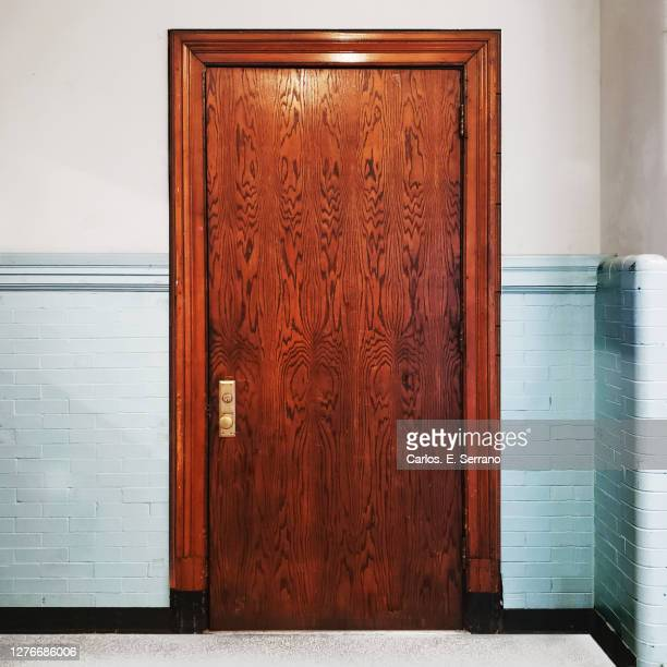 huge old tall oak school door - yonkers stock pictures, royalty-free photos & images