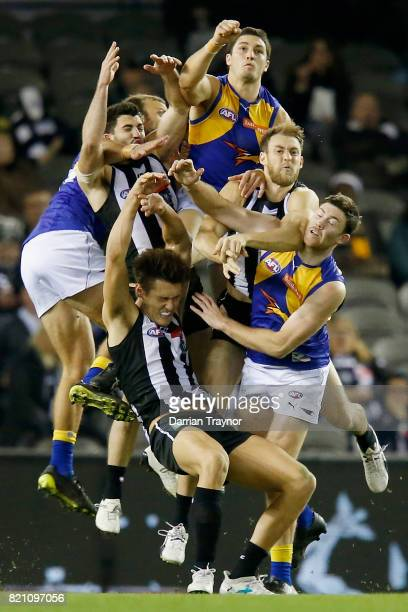 A huge pack of players compete for the ball during the round 18 AFL match between the Collingwood Magpies and the West Coast Eagles at Etihad Stadium...