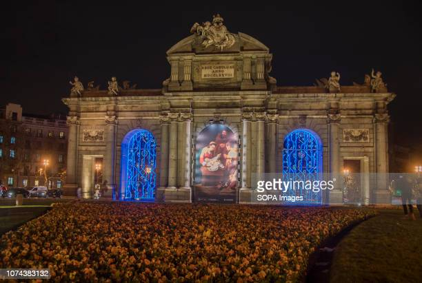A huge painting of Christmas Nativity Scene seen being projected at the Puerta De Alcala monument in Madrid