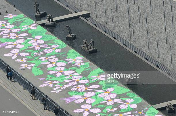A huge painting of orychophragmus violaceus is seen in front of the Memorial Hall of the Victims in the Nanjing Massacre by Japanese Invaders on...