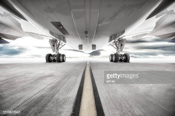 a huge plane on the runway of an airport - 飛び立つ ストックフォトと画像