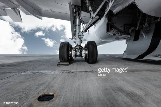 a huge plane on the runway of an airport - 着陸する ストックフォトと画像