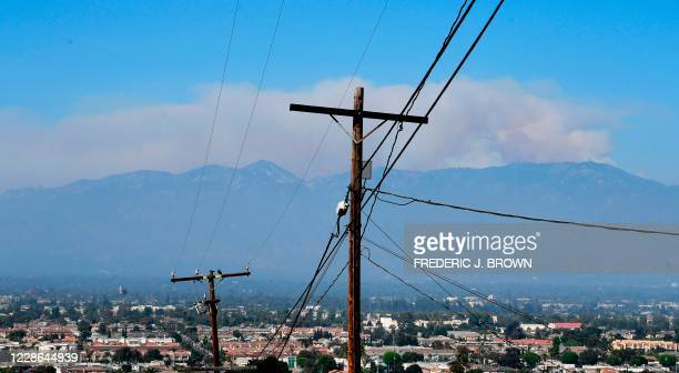 Huge plume of smoke from the Bobcat Fire rises from the Angeles National Forest over the San Gabriel Mountains as seen from Monterey Park, California...