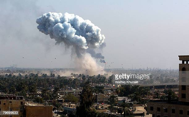 A huge plume of smoke rises from powerful explosions near the offices of the head of the Islamic Supreme Council of Iraq Shiite cleric Abdul Aziz...