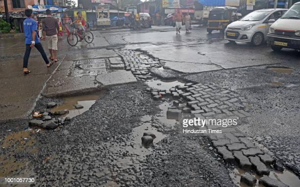 Huge Potholes on Jogeshwari Vikhroli Link Road at Jogeshwari on July 17 2018 in Mumbai India The potholed roads in Mumbai and its surrounding areas...