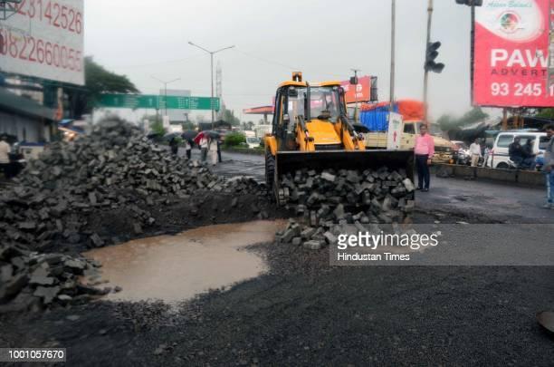 Huge potholes on WEH under Jogeshwari on July 17 2018 in Mumbai India The potholed roads in Mumbai and its surrounding areas have led to several road...