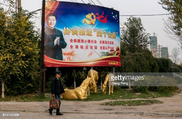 A huge propaganda poster stands at roadside on which President Xi is calling people to deepen reform and enforce legislation