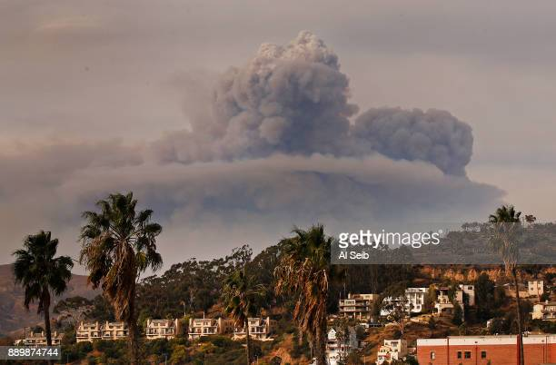 Huge Pyrocumulus cloud of smoke rises to the north of downtown Ventura as seen Sunday afternoon from the Ventura Pier as the Thomas Fire threatens...