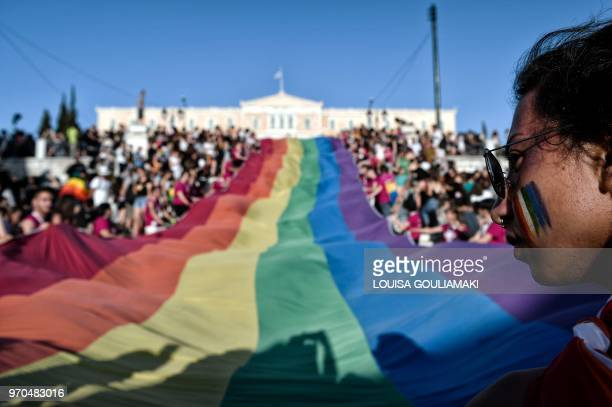 A huge rainbow flag is seen in front of the greek parliament in Athens during the annual Gay Pride Parade on June 9 2018 Thousands of people took to...