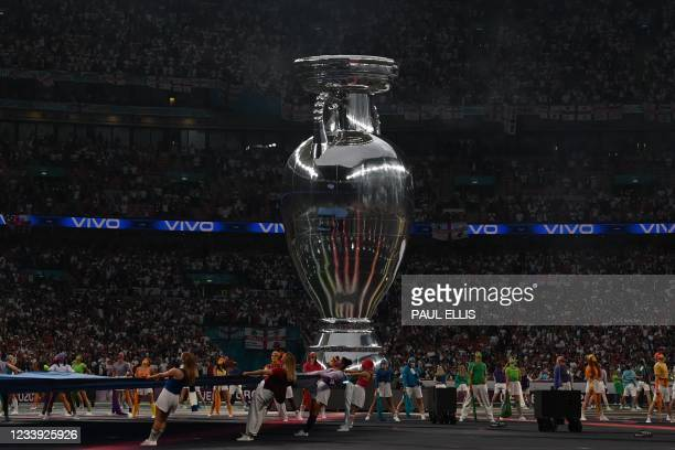 Huge replica of the Europian Championship trophy is brought onto the pitch for the opening ceremony of the UEFA EURO 2020 final football match...