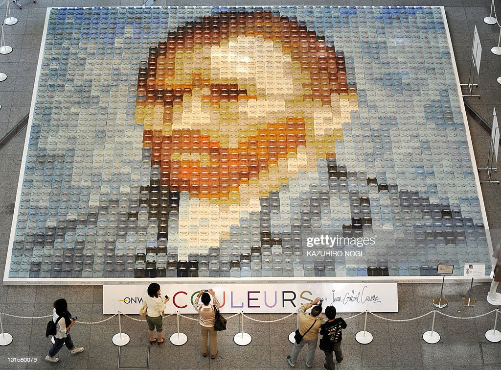 A huge reproduction of Vincent van Gogh's self-portrait made of 2,070 polo shirts in 24 colors, is displayed on the ground floor of the Marunouchi Building in Tokyo on May 16, 2010. The mosaic, measuring about 10 by 10 meters, was created by Japan's apparel maker Onward Kashiyama Co. AFP PHOTO/Kazuhiro NOGI