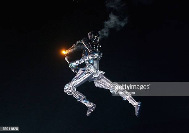 Huge robot is used to light the game's flame during the opening ceremony of China's 10th National Games at the Nanjing Olympic Sports Centre on...