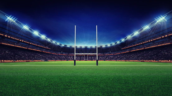 huge rugby stadium with fans and green grass 1056806530