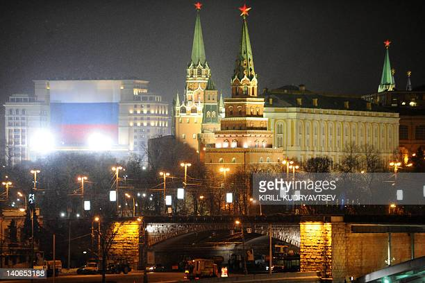 A huge Russian flag is seen on the facade of Moskva hotel just outside the Kremlin in central Moscow on March 4 2012 Russians voted on Sunday in...