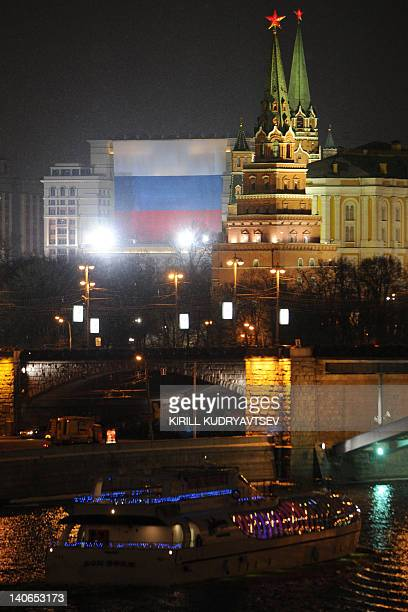 A huge Russian flag seen on the facade of Moskva hotel just outside the Kremlin in central Moscow on March 4 2012 Russians voted on Sunday in...