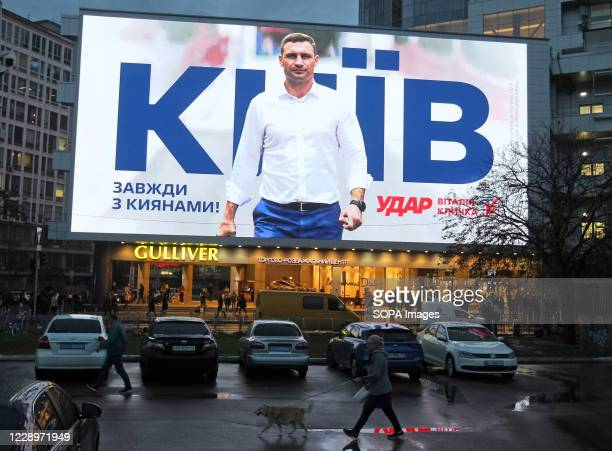 Huge screen shows an election campaign ad of former boxing heavyweight world champion and current mayor of Kiev Vitali Klitschko ahead of Ukrainian...