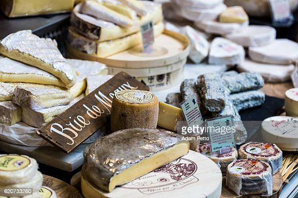 Huge selection of cheeses on stall, Borough Market, London, UK