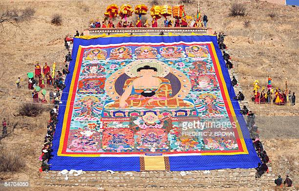 A huge silk thangka showing the image of Sakyamuni the founder of Buddhism is unfurled for a few minutes during the Sunning of the Buddha on a...