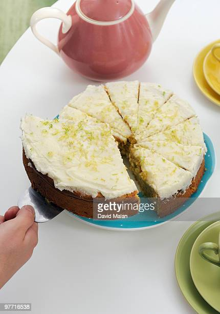 Huge slice of cake being lifted from plate
