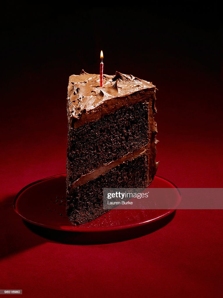 Cool Huge Slice Of Chocolate Birthday Cake On Red High Res Stock Photo Funny Birthday Cards Online Alyptdamsfinfo