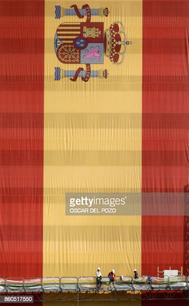 Huge Spanish flag covers the facade of building under construction in Valdebebas neighborhood in Madrid, October 12, 2017. - Spain marks its national...