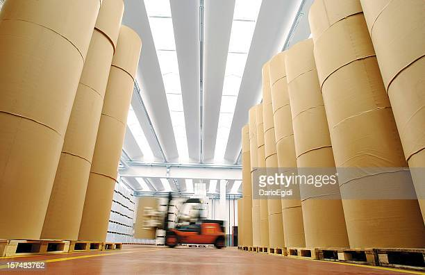 Huge spools of paper in warehouse of a printing company