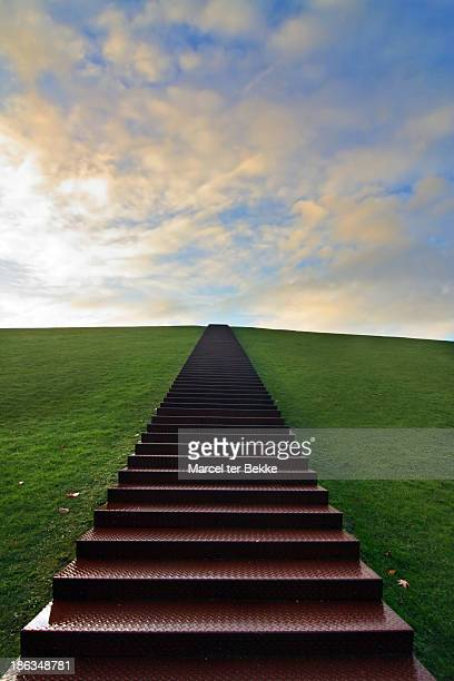 Huge stairway leading up a green hill