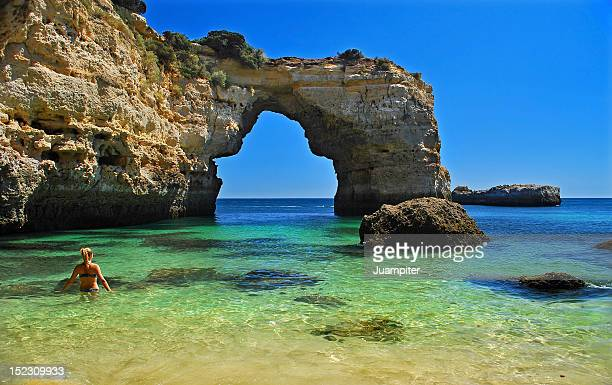 huge stone arch - faro stock photos and pictures