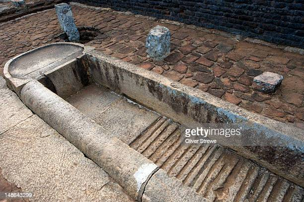 huge stone troughs for storing water and  dyeing robes, alms hall, ancient ruins. - mihintale stock pictures, royalty-free photos & images