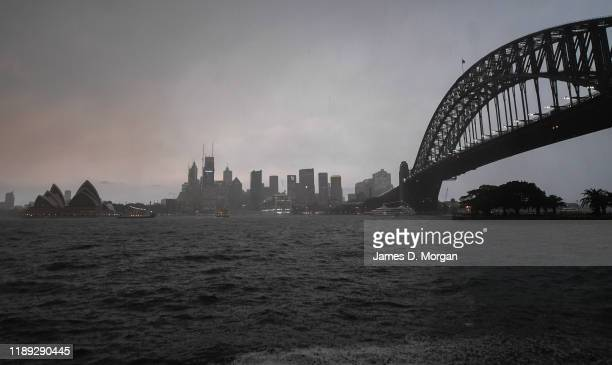A huge storm over Sydney has brought nighttime to daytime near the Sydney Harbour Bridge and Opera House on November 22 2019 in Sydney Australia Most...