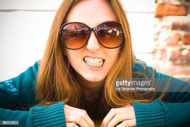 huge sunglasses - clenching teeth stock pictures, royalty-free photos & images