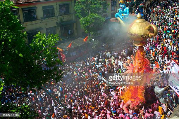 A huge the Idol of lord Ganesha is showered with flower petals while it is being taken when it is taken for immersion There is a lot of fervour...