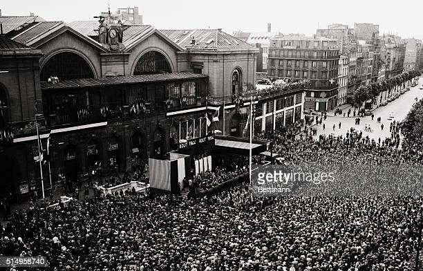A huge throng gathers in front of the Paris railway station to attend ceremonies making the tenth anniversary of France's liberation in World War II...