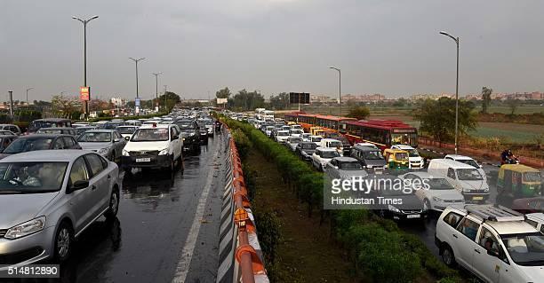 Huge traffic Jam due to the Art of Living foundation's 3daylong World Culture Festival Near Akshardham Temple on NH24 on March 11 2016 in New Delhi...